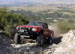 Long-Travel Tacoma blasting down trail